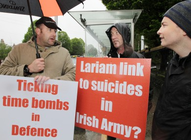 Ex soldiers Trevor Delaney and Paddy Gilford with MEP Paul Murphy protesting about outside the Burlington Hotel in Dublin last June.