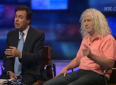 Alan Shatter alleged that Mick Wallace had benefitted from Garda discretion by avoiding penalty points when he was caught using a phone while driving.