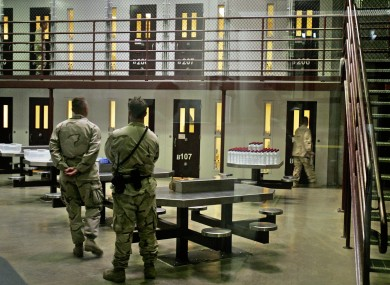 Guantanamo guards keep watch over a cell block (File photo)