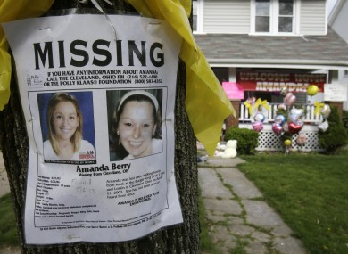 A missing poster still rests on a tree outside the home of Amanda Berry
