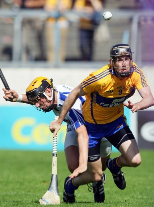 Clare's Pat Donnellan and Waterford's Maurice Shanahan.
