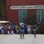 A crowd watches as President Barack Obama takes a tour of Goree Island, Thursday, June 27, 2013, in Goree Island, Senegal. Goree Island is the site of the former slave house and embarkation point built by the Dutch in 1776, from which slaves were brought to the Americas. (AP Photo/Evan Vucci)