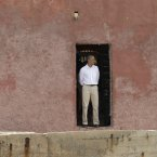 U.S. President Barack Obama looks out to sea through the 'Door of No Return,' at the slave house on Goree Island, in Dakar, Senegal, Thursday, June 27, 2013. Obama is calling his visit to a Senegalese island from which Africans were said to have been shipped across the Atlantic Ocean into slavery, a 'very powerful moment.' President Obama was in Dakar Thursday as part of a weeklong trip to Africa, a three-country visit aimed at overcoming disappointment on the continent over the first black U.S. president's lack of personal engagement during his first term.(AP Photo/Rebecca Blackwell)