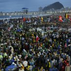 Thousands of young pilgrims gather on Copacabana Beach for a World Youth Day Mass in Rio de Janeiro, Brazil, Tuesday, July 23, 2013. Pope Francis returned to his home continent for the first time as pontiff, embarking on a seven-day visit meant to fan the fervor of the faithful around the globe. (AP Photo/Jorge Saenz)