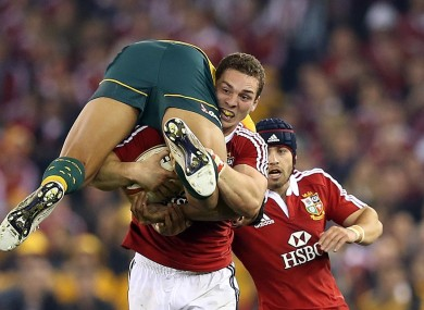 George North takes Israel Folau for a ride in Melbourne.