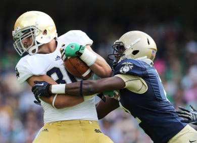 Navy's Parrish Gaines tackles Tyler Eifert of Notre Dame during last year's Emerald Isle Classic.