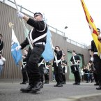 The Irish Republican's parade through the town. (AP Photo/Peter Morrison)