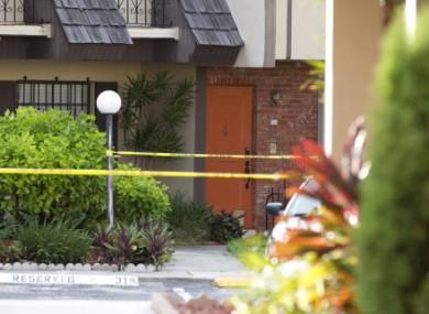 Police tape blocks the entrance to a murder scene in Miami