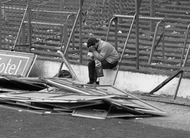 A Liverpool fan sitting on the terraces at Hillsborough after the stadium disaster where 96 fans lost their lives.