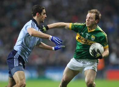 Dublin's James McCarthy tackles Darran O'Sullivan of Kerry.
