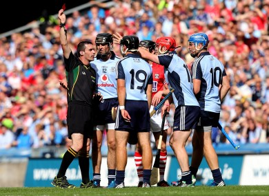 Referee James Owens issues Dublin's Ryan O'Dwyer with a red card after being issued with his second yellow card.