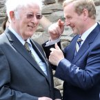 Heaney with Taoiseach Enda Kenny at the Kennedy homestead in Dunganstown Co Wexford in June.<span class=