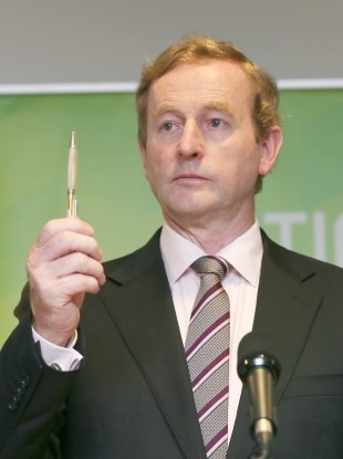 Enda Kenny with a pen.