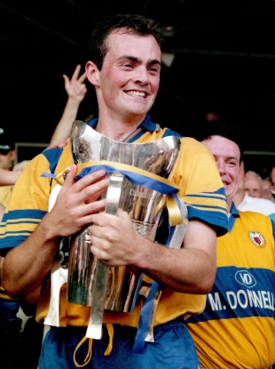 Clare captain Anthony Daly with the Liam MacCarthy trophy after breaking the curse of Biddy Early.