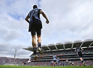Denis Bastick and the Dublin players make their way onto the pitch before the start of the game last weekend.