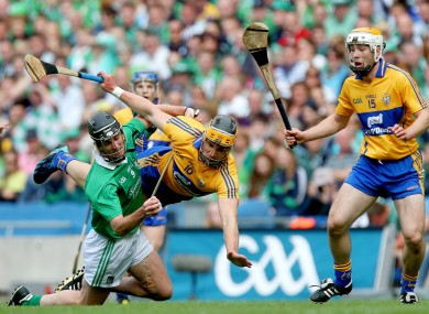 Limerick's Donal O'Grady and John Conlon of Clare battle for possession.
