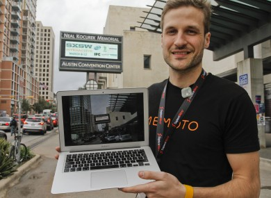 Memoto co-founder Oskar Kalmaru displays a picture taken just moments before with his collar-mounted