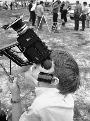 A child squints at a solar eclipse in 1970.