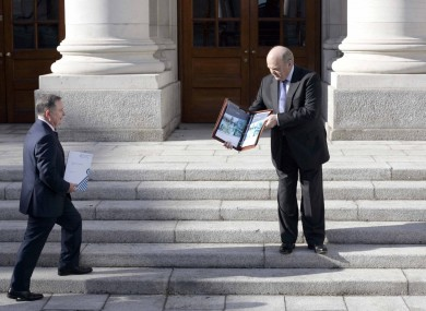 Brendan Howlin and Michael Noonan posing for photographs before today's Budget speech.