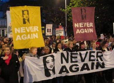 Abortion rights protesters bearing pictures of Savita Halappanavar march through central Dublin last year.