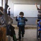 A Syrian teacher leads a class on Thursday. <span class=