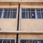 A Syrian girl looks out of a window on Thursday.<span class=