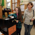 11-year-old Celine helps her mother Bernie Cryan cast her ballot at Drumcondra National School, Drumcondra, Dublin.<span class=