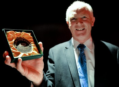 Former Dublin star Barney Rock displays his Hall of Fame award.