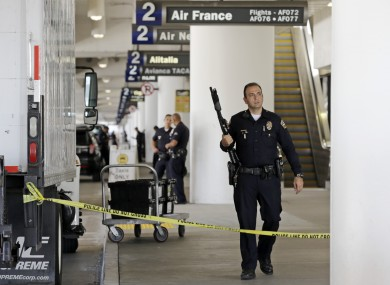 Police stand guard in Terminal 2 at Los Angeles International Airport