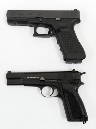 File Photo: A Glock 17 9mm pistol (top) and its predecessor a Browning 9mm.
