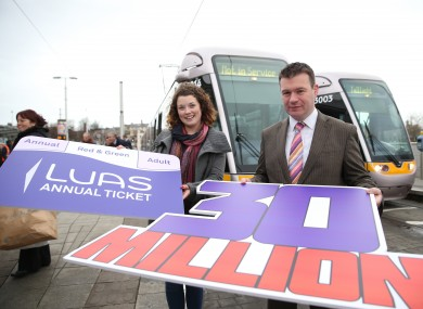 Minister Alan Kelly (right) with the 30 millionth Luas passenger this year, Rachel Williams.