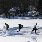 Clearing a lake to play ice hockey <span class=