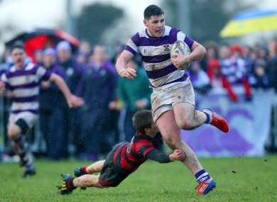 Clongowes Wood's Cian O'Donoghue gets past Liam O'Sullivan of Kilkenny College.