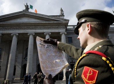 Captain Eoin Rochford poses with a copy of the Proclamation at the GPO.