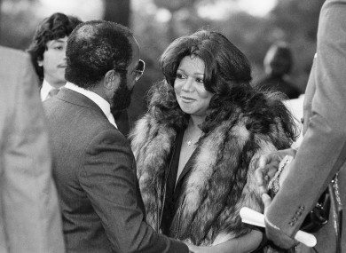 Motown Records founder Barry Gordy offers consolation to his sister Anna Gordy Gaye at a public visitation of Marvin Gaye's body in 1984.