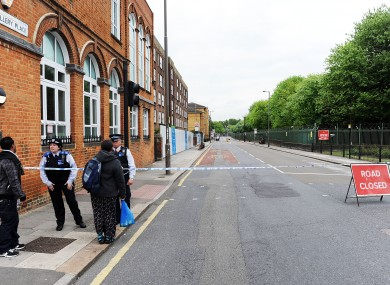 Police close off a road close to the scene were Lee Rigby was murdered.