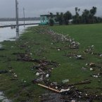 Rubbish left behind after the seawall was breached in Clontarf.<span class=