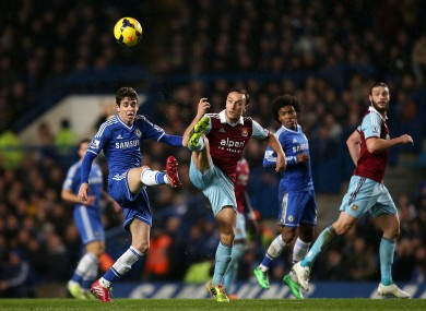 Chelsea's Oscar (left) and West Ham United's Mark Noble battle for the ball
