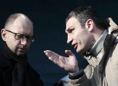 Chairman of the Ukrainian opposition party Udar (Punch), Vitali Klitschko, speaks to opposition leader Arseniy Yatsenyuk.