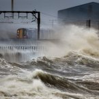 A train passes through the coast at Saltcoats in Scotland, as Britain is braced for the worst as a combination of high tides, heavy rains and strong winds are expected to bring yet more severe flooding to parts of the country.<span class=