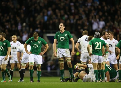 Ireland's players show their disappointment after the final whistle.