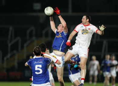 Tyrone's Ronan McNabb with Cavan's Michael Argue.