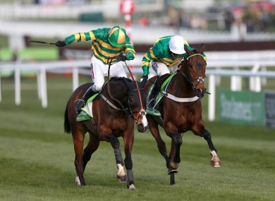 Jezki ridden by Barry Geraghty from My Tent Or Yours ridden by Tony McCoy (right).