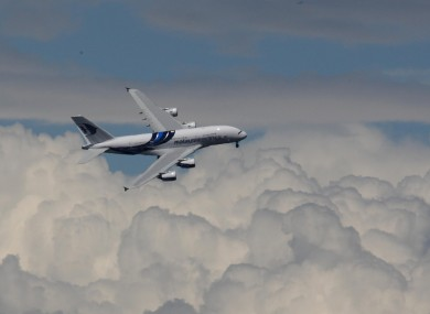 A Malaysia Airlines Airbus performing a flypast in 2012.