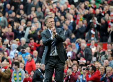 Manchester United manager David Moyes salutes the fans as he leaves the pitch after his team's 4-1 win.