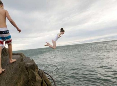 Members of the public pictured at the Forty Foot in Sandycove for the annual traditional Christmas swim.
