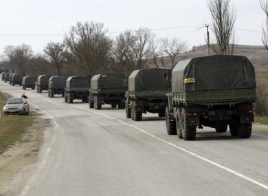 A convoy of military vehicles bearing no license plates travels on the road from Feodosia to Simferopol in the Crimea, Ukraine, today.