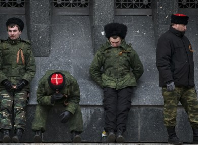 Cossacks guard the regional parliament building during the Crimean referendum