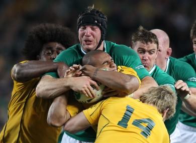 Stephen Ferris unleashes a choke tackle on Will Genia.