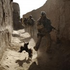 A Canadian soldier chases a chicken seconds before he and his unit were attacked.<span class=